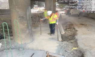 Checking depth of holes drilled on jacking support excavation for PCC median barrier footer