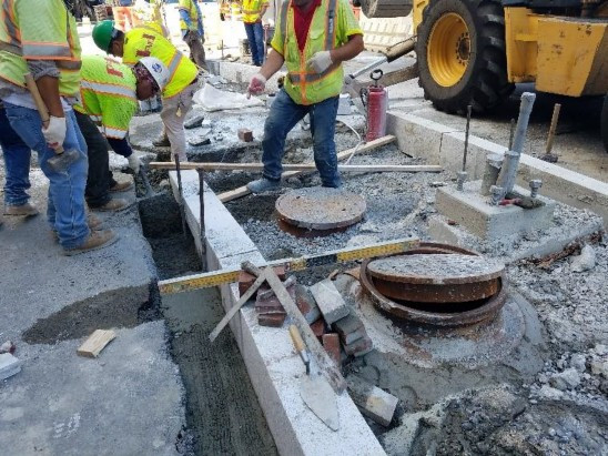 Granite curb installation and grade check by FMCC