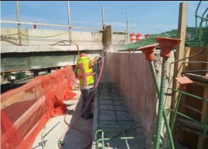 Sand blasting debris from drilled hole for rebars installation on Abutment-A Beam Seat (I-295NB) over S. Capitol St. SEB