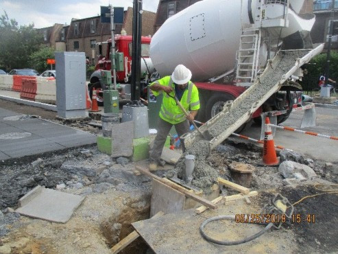 Omni installing the Street Light Pole Foundation TS29 within the area of the proposed Bus Island at 14th & S Street NW