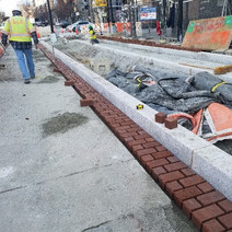 FMCC placing brick gutter at SEC of 14th & Fla. Ave