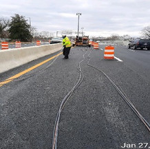Installing Electric Cables at East Approach Median Barrier.