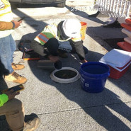 Performing infiltration test as per ASTM Testing procedure for Pervious sidewalk.
