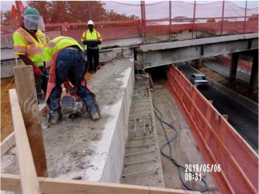 """Sawcutting on Bridge 1016 abutment B backwall for 3"""" perforated pipe."""