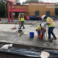 Performing test for pervious concrete sidewalk at (Randle SE-Malcolm X) (Core Drilling) Sta:57+95