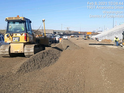 Suitland Parkway-placing, grading and compacting aggregate base course along RW-6