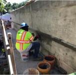 Padro crew finisher working on parapet wall on bridge#1017 sb I-295