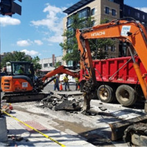 """Demolition and excavation by Omni at NEC of 14th & R St for 12"""" main work"""