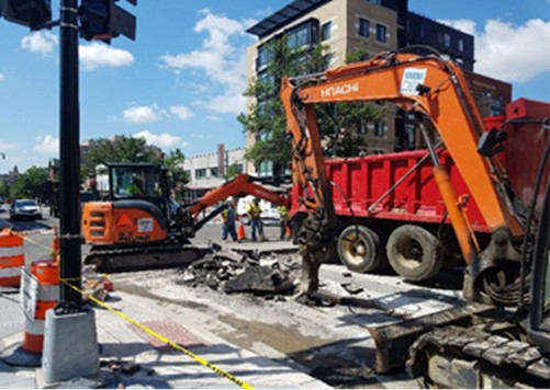 "Demolition and excavation by Omni at NEC of 14th & R St for 12"" main work"