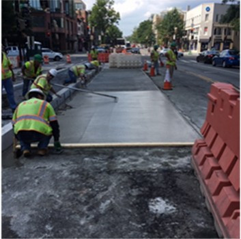FMCC finishing up the concrete work for the installation of the Bus Pad at the southeast corner of 14th & Rhode island Street NW