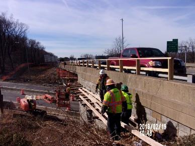 Installing work platform on Bridge 1016 Wing Wall 1