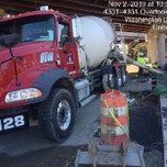Placing class B concrete in PCC half curb barrier footing on South Capitol St. SW.