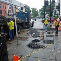 Following removal of bus shelter cracks patches in sidewalk were cleaned up and patched with temporary asphalt