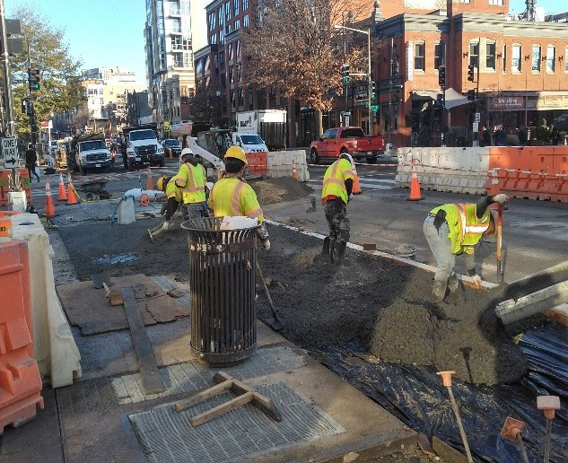 """DEN pouring the 4"""" PCC Sidewalk at T Street & 14th Street NW"""