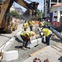 FMCC install bus island with dry concrete mix at 14th St. NW & R St.