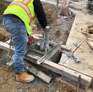 Placing PCC Concrete at foundation of L1 located at NW Corner of 5th & MLK NB RT
