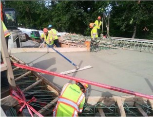 Finishing process on poured concrete-Approach and Moment Slab of Bridge # 1017 over I-295 SB