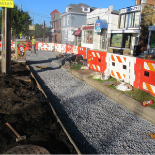 Preparation for pervious concrete sidewalk at Sta. 45+50 to Sta. 47+50