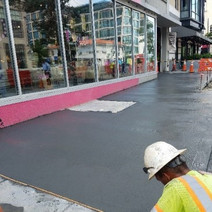 Finishing of PCC sidewalk and view of existing building vault to be replaced