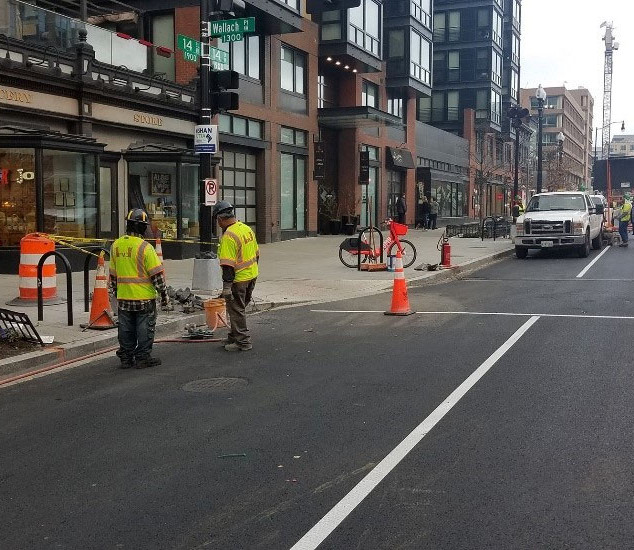 A small FMCC crew working on streetlight
