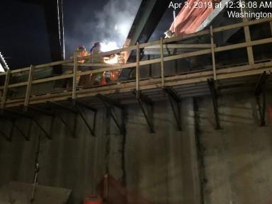 Loosening bolts on the end diaphragm on Bridge 1016 Abutment B