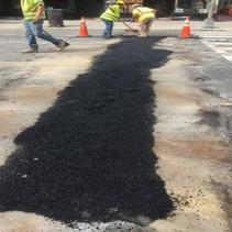 Placing temporary asphalt over PCC base