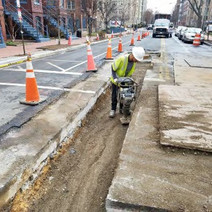 Contractor compacting Backfill Material on N Street