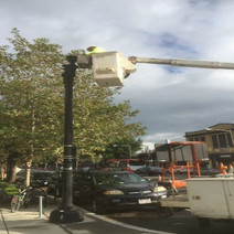 Installing the 100-watt LED and Globes on the Twin 20 Street Light Poles