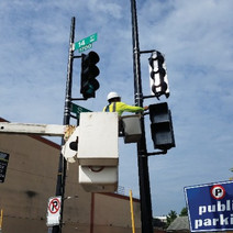 FMCC Electrical installing pedestrian signals at SWC of 14th & S St.
