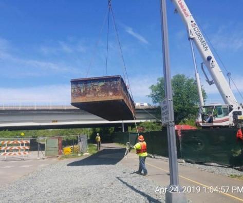 Unloading Barges into Anacostia River, Southwest of the Bridge