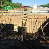 Stripping Backwall forms, East Approach South Bridge.