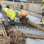 Installing rebars on Bridge 1016 deck extension span 1