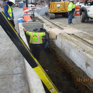 Installing 3-ply Membrane and Geotextile placement at Bio-retention. PR2020-BR1