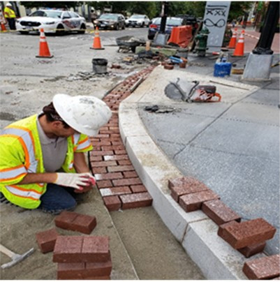 """DEN placed Brick Gutter and Granite at 1350 Florida Ave. at Crosswalk at 14th St. NW Intersection. But, DEN Saw Cut PCC base by 6"""" beyond the 12"""" Brick Gutter & It will be fixed later & it fells within Bus Island Zone."""