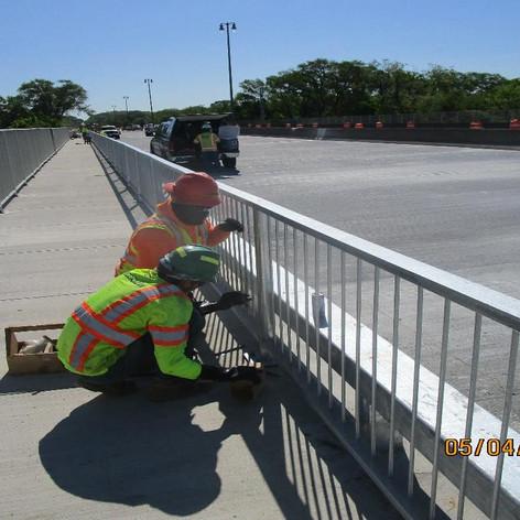 """Adjusting 42"""" Pedestrian Railing, North Bridge."""