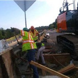 Placing concrete in parapet wll between existing parapet wall and wingwall 1 on SB-295