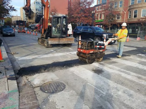 Placing temporary Asphalt over Electrical Trenched between W and V Street