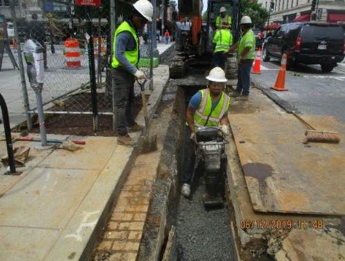 Omni compacting the backfill material in the trench excavated for the installation of 8-Inch D.I.P at R Street NW