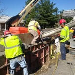 Placing concrete in PCC barrier wall on South Capitol St SE, left of travelling lane.