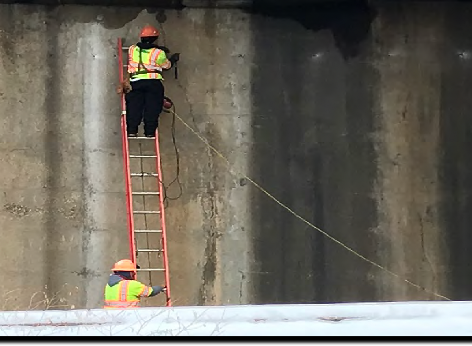 "Contractor is installing expansion bolts to support brackets for scaffolding at 1016 & 1017 abutments ""A"" on S. capitol St. NB"