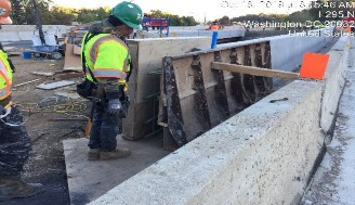 Forming modified safety shape barrier on southwest corner of Bridge 1016