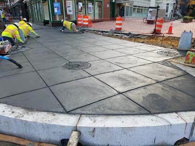 Placement of PCC Sidewalk at SW corner of Rhode Island Ave