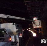 Installing under bridge lighting on South Capitol St. SE