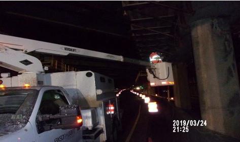Installing under bridge lighting on South Capitol St. SE