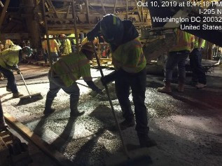 Placing Latex concrete on Bridge 1016, left of the baseline.