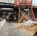 Demolition in progress for proposed jerking foundation, under Pier of Bridge # 1016 on S. Capitol St. SEB.