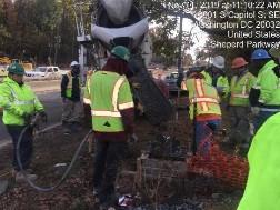 Placing concrete in light pole L2 foundation