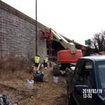 Installing work platform on Bridge 1017 Wing Wall 1