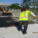 Placing Temporary Asphalt at West Approach, North Bridge