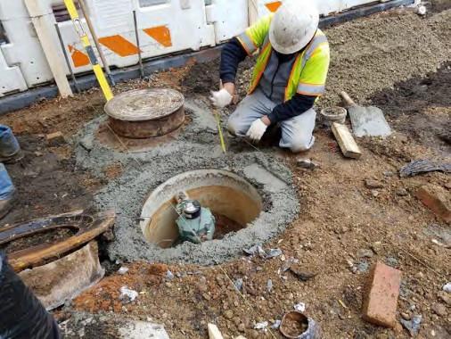 Utility Manhole Adjustment between N Street and Rhode Island Ave